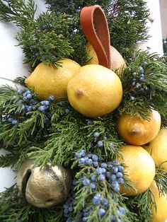 Christmas Lemon Swag-great creative mix with juniper berry branches and jingle bells. Would also make nice tree decorations, blue and yellow. From Williamsburg, VA.