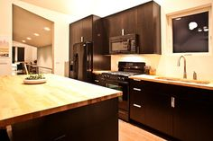 pictures of walnut cabinets with butcher block counters | butcher block kitchen contemporary kitchen