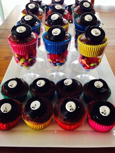 Disco cupcakes in wine glass filled with smarties record on cupcake made with licorice circle