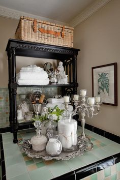 This is a nice bathroom vignette idea with glass jars filled with bath items on a silver tray.