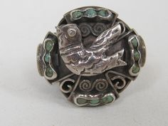 Vintage Mexican Silver & Turquoise Ring- Silver Dove at its center has a design familiar to any Mexican Silver Jewelry collector as originating with the famous Matilde Poulat or MATL.  Beautifully crafted with a ornate stylized Dove accented with natural Turquoise stones with applied silver wire work that wraps completely around the ring....  Merry Christmas to me!! I bought this fantastic ring for myself!!