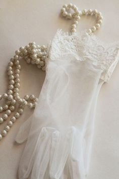 White lace gloves and pearls