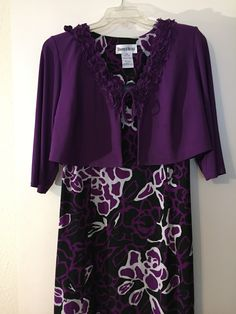 "This is a lovely Danny & Nicole brand two piece floral dress set. The dress is below the knees, sleeveless, and has a purple, black and white floral pattern. The cover jacket is purple with a tie front closure. This is a gently used item in excellent condition. Size 14W    Dress Measurements:     44"" Bust     42""Waist     41"" Length from shoulder to hem.    Jacket Measurements:    18.5"" Sleeve     17"" Length from shoulder to hem    47"" Bust    and ships immediately! 📦 Also available for…"