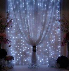 Fairy lights in girl's room window
