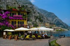 Restaurant at the harbour of Limone Dramatic rock location in Limone, Lake Garda (Italy) - Learn more about Limone sul Garda in my blog post! #Limone #LimonesulGarda #LagodiGarda #Gardasee #LakeGarda #Lombardy #Lombardia #Lombardei