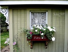 Curb appeal - Love this window box with the corbels underneath and the stencil on the box...so cute!