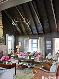 The heaviness of this Missouri cottage's dark interior is lightened with soft blue-and-ivory fabrics and creamy sofas.