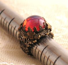 King's Crown with Dragon's Breath Jewel - Filigree Ring by Lorelei Designs. $51.00, via Etsy.