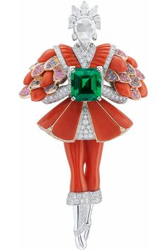 Van Cleef & Arpels - Prince rouge clip, Fairytale Collection Peau d'Âne (Donkey Skin), Paying tribute to one of the tale's major characters, the Prince rouge clip is among the rare masculine figures created by Van Cleef & Arpels. Combining gold, gems and vermilion coral, the suit called for carving, stone-cutting and setting of great precision and is testimony to the Maison's excellence. 2014