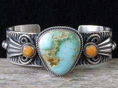 Cuff | Albert Jake. (Zuni Pueblo). Sterling silver, Royston Turquoise & Orange Spiny Oyster