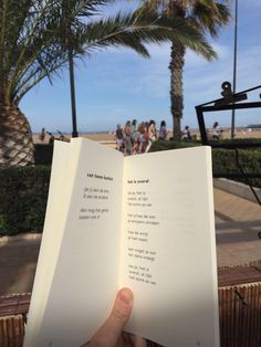 Beachtime is reading time!  #hetisoveral #valencia #palmslag #poetry #palmtrees #beach