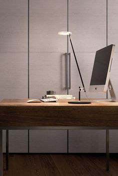 With its two cantilevered arms in aluminium, and a head made from injection moulded polycarbonate, the pared down Linea desk lamp from Kundalini lends an air of sophistication and order to its surroundings.  Furthermore, it   comes in black or white. Find out more at: http://www.italian-lighting-centre.co.uk/modern-plastics-lamps/grey-white-black-modern-linea-task-light-from-kundalini-p-3573.html#.VUjSwflViko