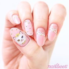Cat Princess Nail Art The pink polish I used is Bardot from @picturepolish  The tiny metal studs and the clear rhinestone are from @bundlemonster ✨ The cat and lines are hand painted with acrylic paint More details are on my blog & the link is on my bio A Halloween mani is coming up next☺️