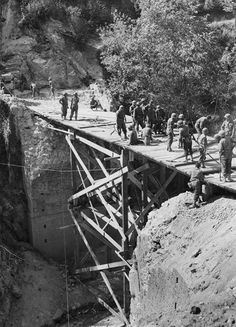 5th Army engineers finish a bridge across a streambed in central Italy to replace the span destroyed by German demolitionists. In twenty months of fighting in Italy the Allies would erect three thousand spans with a combined length of fifty-five miles.