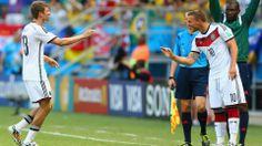SALVADOR, BRAZIL - JUNE 16: Thomas Mueller of Germany (L) exits the game after scoring a hat trick as Lukas Podolski comes on during the 2014 FIFA World Cup Brazil Group G match between Germany and Portugal at Arena Fonte Nova on June 16, 2014 in Salvador, Brazil. (Photo by Martin Rose/Getty Images)