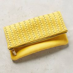 Best Gifts Under $100: A woven foldover clutch in a tropical banana yellow hue is just the pop a beach ensemble needs. | CoastalLiving.com