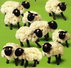 Cauliflower sheep! heads = black olives, eyes = black eyed peas, bodies = cauliflower, legs = clove
