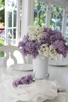 Arrangement of lilacs in a white glass vase. Just need to wait til next spring for my new lilac bush to bloom! Lilac Flowers, Purple Lilac, Fresh Flowers, Spring Flowers, Beautiful Flowers, Lavender Cottage, Olive Garden, Arte Floral, Decoration Table