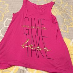 Tank top Exercise tank top pink in color with the saying give more take less on the front in black and gold letters size large Gaiam  Tops Tank Tops
