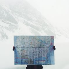 Buy a map to take with you every where you travel. Mark the map as you go and take a picture like this at each location.