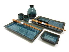 Set up a perfect evening with a sushi and sake set. Choose from a selection of sushi dinnerware to enhance your dining experience. Each serving set comes with two sushi plates, two soy sauce dishes, two pairs of chopsticks, a sake bottle and cups. Sushi Set, Pottery Plates, Ceramic Pottery, Sushi Comida, Sake Sushi, Sushi Platter, Raku Kiln, Pottery Handbuilding, Advanced Ceramics