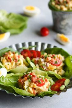 BLT Egg Salad in a lettuce wrap on a plate.