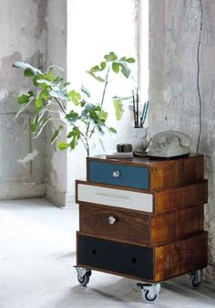 House Doctor DK Wooden side table on wheels