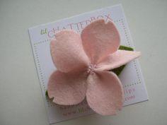 Baby pink wool felt Sakura on a 2 inch snap clip on Etsy, $10.00