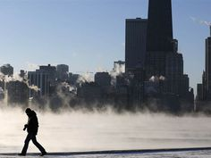 JIM YOUNG / Reuters A man is silhouetted against the arctic sea smoke rising off Lake Michigan in Chicago on Monday.