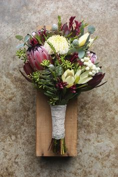I like the deep pink protea with the white and dark green. spring bouquet using natives - white waratah, proteas, leucadendrons, eucalyptus buds, kangaroo paw and berzelia Spring Wedding Flowers, Rustic Wedding Flowers, Wedding Flower Arrangements, Bridal Flowers, Flower Bouquet Wedding, Floral Wedding, Floral Arrangements, Protea Bouquet, Rustic Bouquet