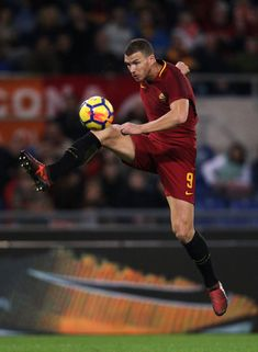 Edin Dzeko Photos - Edin Dzeko of AS Roma in action during the Serie A match between AS Roma and Bologna FC at Stadio Olimpico on October 28, 2017 in Rome, Italy. - AS Roma v Bologna FC - Serie A