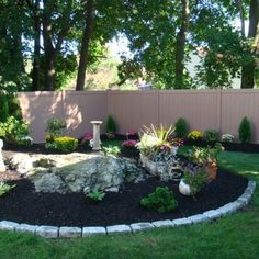 Complete Design with Cobblestone Borders with plantings and Custom Vinyl Fence with wood grain look   Yelp