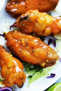 Spicy Honey Lime Chicken Wings - crispy, baked chicken wings tossed in a sweet and spicy sticky honey lime sauce!