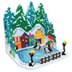 <p>Create this amazing 3D holiday scene, complete with village, lamp posts, and skating penguins! Easy tab/slot assembly, and fun for the whole family.</p>