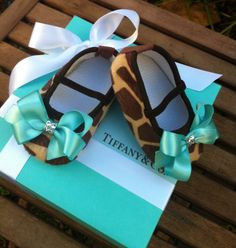 Tiffany & Co Inspired Giraffe Infant Crib Shoes by RockkandyKids ... I love the idea of using these as nursery decor!  Threading some ribbon through them ... love!!!
