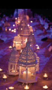 Learn how to use lanterns as decorations in your wedding reception! Lanterns provide romantic and soft lighting which makes them perfect for your wedding reception. Especially if you're having an outdoor wedding, lanterns make the perfect lighting. Arabian Nights Party, Arabian Party, Moroccan Lanterns, Moroccan Lamp, Moroccan Garden, Moroccan Lighting, Candle Lanterns, White Lanterns, Green Candles