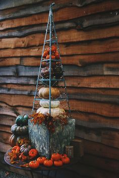 Reduce the use of extra decor by creating a transitional piece like this pumpkin tower from the Free People blog that will last all the way from fall to early winter!