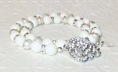 Hey, I found this really awesome Etsy listing at https://www.etsy.com/listing/225386338/crystal-pearl-double-strand-bracelet