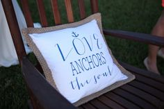 DIY personalized pillows for rocking chairs at wedding. Love anchors the soul