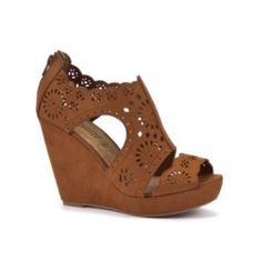 I adore these lace inspired cut out wedges, they are perfect for the summer! Start the summer in style with these tan laser cut wedges. Team with cute floral dresses for a glamorous, girly evening look. Zip up ankle fasteningPeep toe