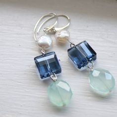A lovely combination of faceted prehnite semi precious stones, blue Swarovski Crystals and freshwater coin pearls. Total length of these earrings is 2
