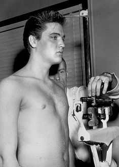 Elvis Presley weighing in during his induction into the army, 1958.