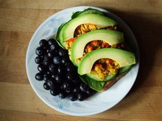 Whole grain flax toast with spinach, cucumber, seasoned chickpeas and avocado, with blueberries.