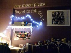 My bedroom with lights, Harry Potter/Arsenal pictures and Panic! at the Disco lyrics on the wall