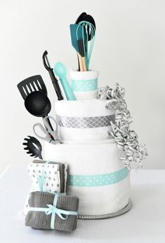Towel Cake: A Fun DIY Bridal Shower Gift Wedding Gifts - A towel cake is a perfect DIY bridal shower gift idea that's easy to make, creative to give and a present the bride will love! Plus, we've got a great game you can play with this towel cake as well! Bridal Shower Gifts For Bride, Bridal Shower Cakes, Bridal Shower Party, Wedding Showers, Themed Bridal Showers, Ideas For Bridal Shower, Best Bridal Shower Games, Wedding Shower Prizes, Teal Bridal Showers