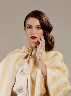Faux fur cape and crochet gloves for an elegant vintage inspired winter wedding look