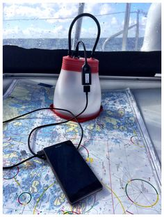 SunBell solar lamp and phone charger at sea