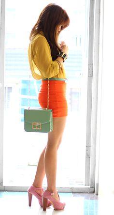Yellow sheer shirt, light green belt, orange mini skirt and light blue purse. #colorblocking #bright