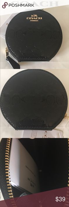 🆕COACH NEW PATENT CHANGE PURSE 💯AUTHENTIC COACH NEW NEVER USED WITH TAGS PATENT MONOGRAM COIN PURSE 100% AUTHENTIC. STUNNING AND STYLISH TOTALLY ON TREND! JUST BEAUTIFUL AND ELEGANT! IT HAS A ROUNDED ZIP CLOSURE. IT MEASURES 4 INCHES WIDE BY 3.75 INCHES TALL. THE COLOR IS BLACK Coach Bags Wallets