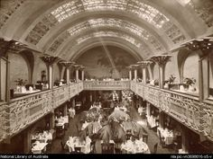 Interior of Cafe Australia at Collins St,Melbourne in Victoria.Designed by Walter Burley Griffin:built 1916 and demolished 🌹 Melbourne Girl, Melbourne Victoria, Victoria Australia, Melbourne Australia, Queen Victoria Market, Victoria Building, Australian Architecture, Vintage Architecture, Historic Architecture
